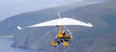 Weightshift microlight flying along the Scottish coast